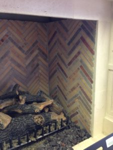 close-shot-of-simulated-firewood-for-interior-fireplace-with-coal-accents-773x1030
