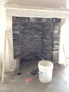 closer-repeat-shot-of-interior-gas-designed-fireplace-construction-in-progress-773x1030