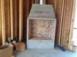 construction-of-elevated-mason-lite-fireplace-in-room-1030x773