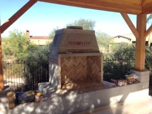 construction-of-elevated-mason-lite-outdoor-fireplace-under-covered-back-veranda-1030x773