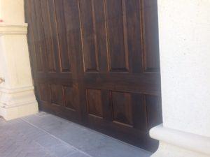 custom-wood-garage-door-with-marble-columns-paradise-valley-1030x773