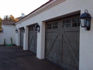 reclaimed-wood-garage-door-paradise-valley-with-reclaimed-brick-header-1030x773