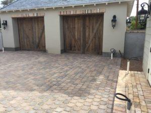 reclaimed-wood-garage-door-phoenix-with-brick-header-pavers-installed-1030x773