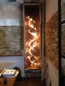tall-interior-fireplace-with-flame-coils-in-a-double-helix-pattern-773x1030